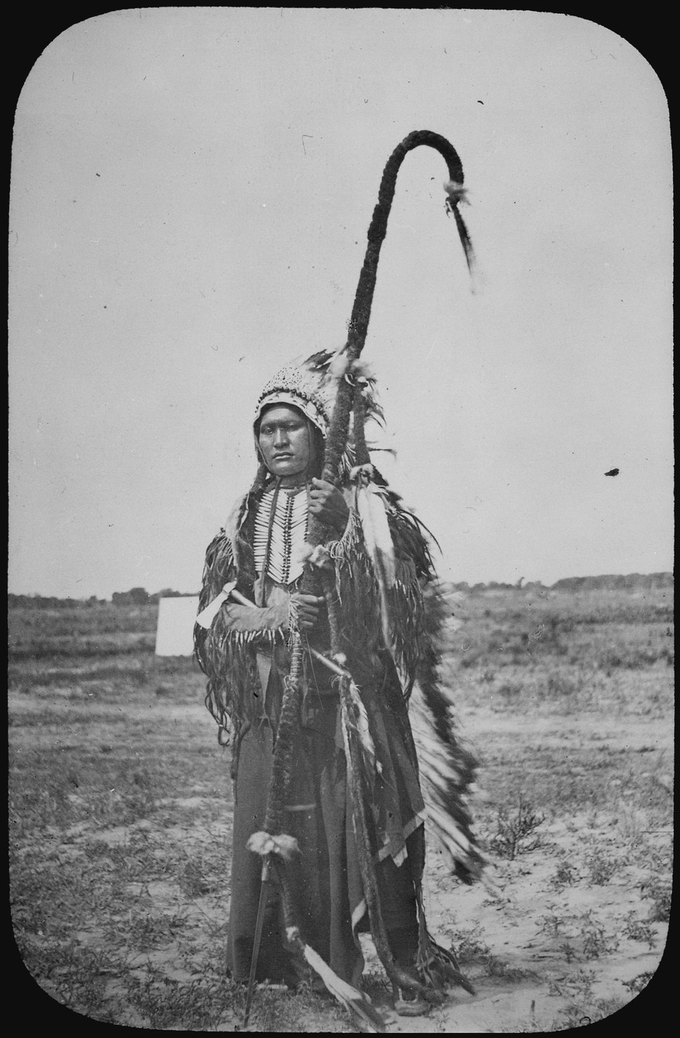 Chief Powder Face of the Arapaho, standing full-length, wearing war costume, 1864 - NARA - 520069