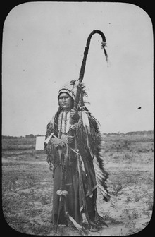 http://upload.wikimedia.org/wikipedia/commons/thumb/a/ac/Chief_Powder_Face_of_the_Arapaho,_standing_full-length,_wearing_war_costume,_1864_-_NARA_-_520069.tif/lossy-page1-220px-Chief_Powder_Face_of_the_Arapaho,_standing_full-length,_wearing_war_costume,_1864_-_NARA_-_520069.tif.jpg