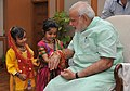 Children tying 'Rakhi' to the Prime Minister, Shri Narendra Modi, on the occasion of 'Raksha Bandhan', in New Delhi on August 10, 2014 (1).jpg