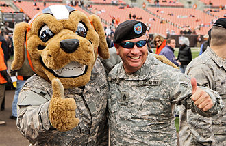 Cleveland Browns - Browns mascot Chomps (shown greeting U.S. National Guard members at FirstEnergy Stadium.)
