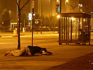 A homeless person sleeping on a street in Clev...
