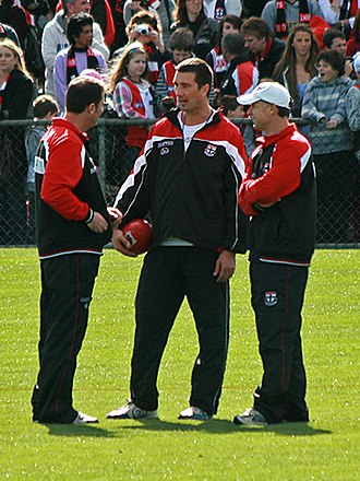 Ross Lyon - Lyon (left) discusses tactics with St Kilda assistant coaches Stephen Silvagni and Tony Elshaug