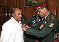 Col. B.K. Majumdar of Kendriya Sainik Board, pinning the lapel on the Defence Minister, Shri A. K. Antony, on the occasion of the Armed Forces Flag Day, in New Delhi on December 07, 2011.jpg
