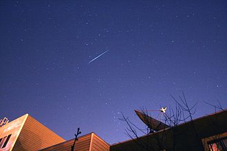 Satellite flare - Image: Comet holmes and iridium flare