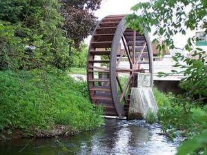 Comstock Park, Michigan - The Mill Creek Water Wheel is a well-known landmark in Dwight Lydell Park downtown.
