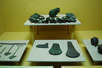 Metallurgy in pre-Columbian Mesoamerica - Copper bells, axe heads  and ornaments from various parts of Chiapas (1200–1500) on display at the Regional Museum in Tuxtla Gutierrez, Chiapas.