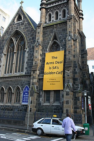 South African Arms Deal - A banner on the Central Methodist Mission church in Green Market Square, Cape Town criticising the South African Arms Deal by comparing it to a golden calf.