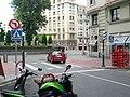 Crosswalk warning signs at entrance to traffic circle (18185616754).jpg