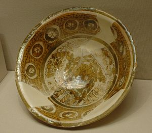 Roland de Mecquenem (archaeologist) - Earthenware cup with metallic lustre and opaque glaze, overglaze painted, 9th century excavated by Roland de Mecquenem in Susa, 1921.