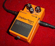 "A Boss ""stomp-box""-style distortion pedal in use."