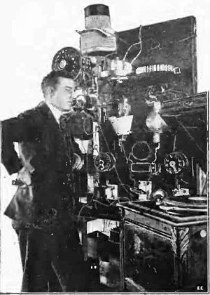 AM broadcasting - Lee de Forest used an early vacuum-tube transmitter to broadcast returns for the Hughes-Wilson presidential election returns on November 7, 1916, over 2XG in New York City. Pictured is engineer Charles Logwood