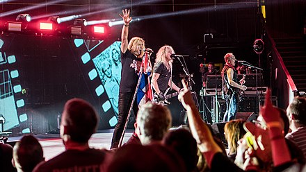 Def Leppard performing at a charity concert for the Teenage Cancer Trust in 2018.
