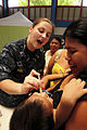Defense.gov News Photo 100825-N-1531D-248 - U.S. Navy Lt. j.g. Katt Rhine gives deworming medication to an infant during a Continuing Promise 2010 medical civic action program in Bribri.jpg