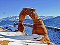 Delicate Arch in Arches National Park draped in a winter snow.jpg