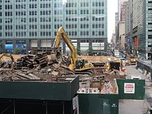 A machine moves demolition debris