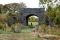 Disused railway bridge by Wolhampcote church (2) - geograph.org.uk - 1544987.jpg