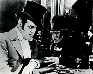 Dr. Jekyll and Mr. Hyde (1920 film) -  John Barrymore (right) as Mr. Hyde with an uncredited Louis Wolheim as a dance hall owner.