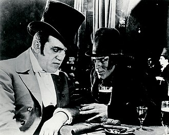 Dr. Jekyll and Mr. Hyde (1920 Paramount film) - Mr. Hyde with owner of music hall (Louis Wolheim) where Gina dances