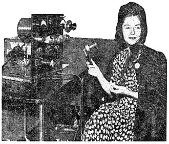 WWJ (AM) - 1941 publicity photograph of actress Dorothy Gish re-creating a 1920 broadcast over the original DeForest OT-10 transmitter.