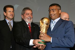Photograph of Romário at the announcement of Brazil hosting the 2014 FIFA World Cup. Photograph taken by Agencia Brasil a Public Brazilian news agency operating under the Creative Commons Attribution 3.0 Brazil License
