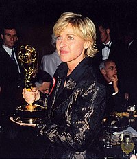 A photograph of Ellen DeGeneres with her 1997 Emmy Award.