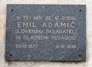 "Emil Adamič - Plaque in Dobrova: ""The Slovenian composer and music teacher Emil Adamič was born in this house (25 Dec. 1877–6 Dec. 1936)"""