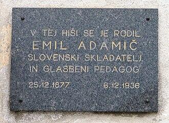 "Emil Adamič - Plaque in Dobrova: ""The Slovenian composer and music teacher Emil Adamič was born in this house (25 Dec. 1877–6 Dec. 1936)"""