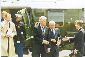 Erskine Bowles -  President Clinton and Bowles (wearing overcoat on the left)