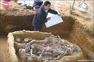 Excavation of corpses of genocide victims.