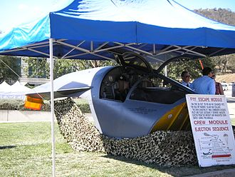 Escape pod - The escape capsule of a Royal Australian Air Force F-111. This capsule saved the lives of the two aircrew when the aircraft crashed in October 1978. Australian War Memorial, 2007