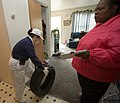 FEMA - 30131 - New Jersey volunteer helps a resident flooded by nor'easter.jpg