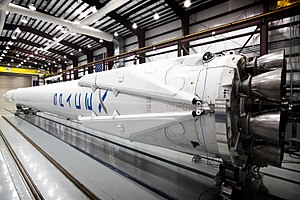 SpaceX reusable launch system development program - Falcon 9 v1.1 with landing legs attached, in stowed position as the rocket is prepared for launch in its hangar