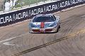Ferrari 458TP Italia Alex Popow Into Turn 10 FCNA Race1 SPGP 24March2012 (14513253897).jpg