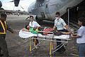 Filipino medical personnel debark an injured Filipino civilian from a U.S. Marine Corps KC-130J Super Hercules aircraft at Villamor Air Base, Metro Manila, Philippines, Nov. 12, 2013 131112-M-FF989-018.jpg