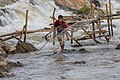 Fisherman throwing his net in Khone Pasoi waterfalls in Don Khon Laos (2).jpg