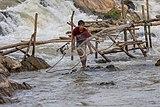 Fisherman throwing his net in Khone Pasoi waterfalls in Don Khon Laos (2).jpg