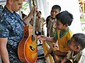 Flickr - Official U.S. Navy Imagery - A Sailor lets local Indonesian children strum his guitar during a Pacific Partnership 2012 community service project..jpg