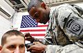 Flickr - The U.S. Army - Barber rejoins service after losing pool game to friend.jpg