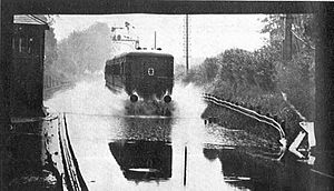 1928 Thames flood - A Southern Railway electric multiple unit tackles floods at Kew Bridge railway station.