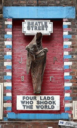 Mathew Street - Mural tribute sculpture to The Beatles by Arthur Dooley