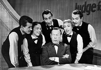 Joe Hamilton (producer) - Hamilton at left with Fred Allen as a member of The Skylarks in 1954, the group was part of the Judge for Yourself cast