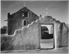 "Full side view of entrance with gate to the right, ""Church, Taos Pueblo National Historic Landmark, New Mexico, 1941."" ( - NARA - 519985.tif"