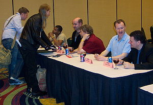 Doctor Who fandom - Fans line up for autographs at the 2006 Gallifrey One convention. Guests, left to right at table: Noel Clarke, Nicholas Briggs, Rob Shearman, Mark Gatiss and Steven Moffat.