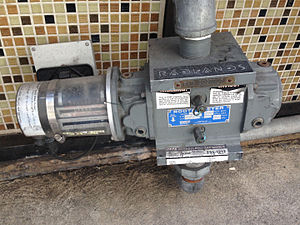 Gas meter - Gas meter with solid-state pulser (left) for remote reading