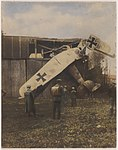 Germans gazing at a crashed AEG G.IV (13960622572).jpg