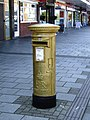 Gold postbox on the High Street - geograph.org.uk - 3132414.jpg