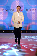 Harsha Bhogle walks for Manish Malhotra & Shaina NC's show for CPAA 21.jpg