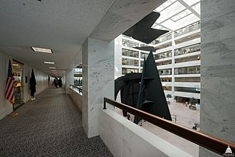 Hart Senate Office Building - Walkway arcades on each floor provide access to the offices of the Hart building, as well as a view of the atrium. A portion of Mountains and Clouds can be seen in this image.