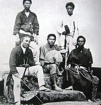 Tōgō Heihachirō - Officers of the Japanese warship Kasuga in August 1869. Third-class officer Tōgō is dressed in white, top right.