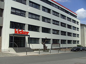 "Kicker (sports magazine) - The head office  of the ""Kicker"" sports magazine in Nuremberg with the Kicker statue in front of the main entrance"